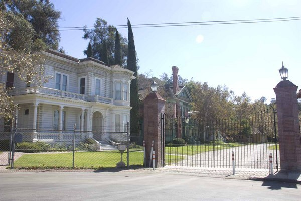 The Perry Masion viewed through the Heritage Square Museum gates.
