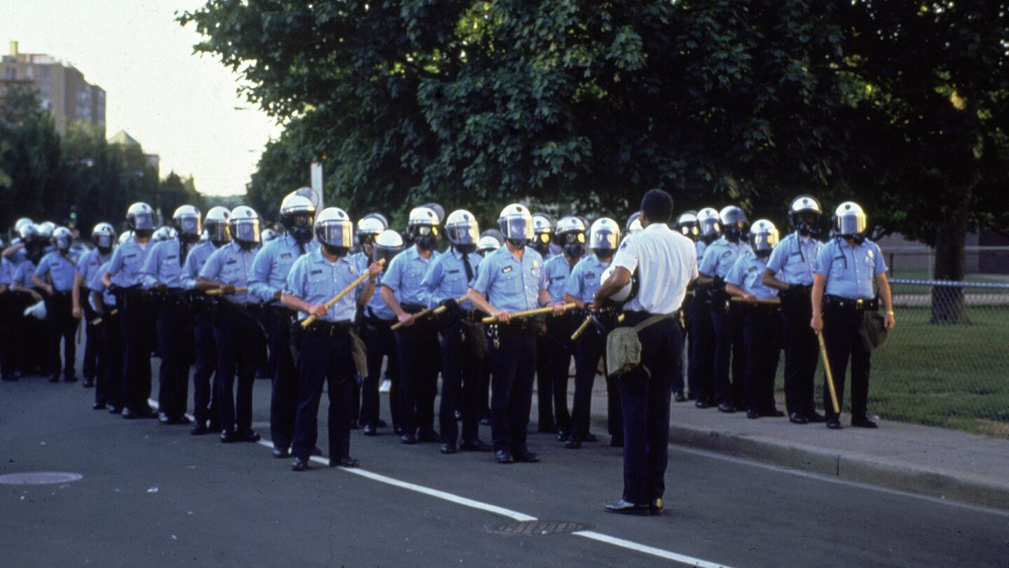 Washington, D.C., April 1992: Police officers stand in formation, wearing helmets and holding clubs, during the riots following the 'not guilty' verdict in the beating of Rodney King. | Consolidated News/Getty Images