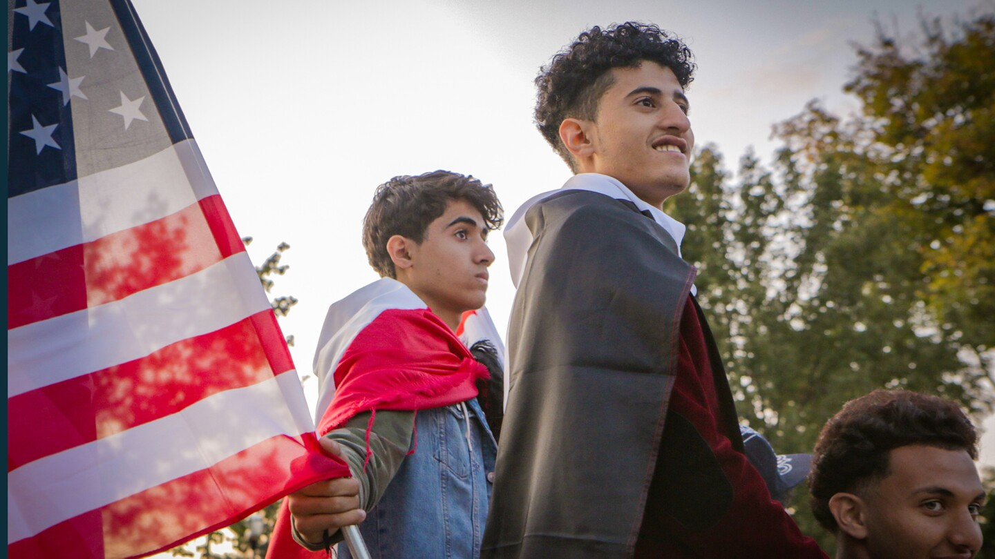 Young Yemeni-Americans display symbols of both countries at a rally to end the war in Yemen.