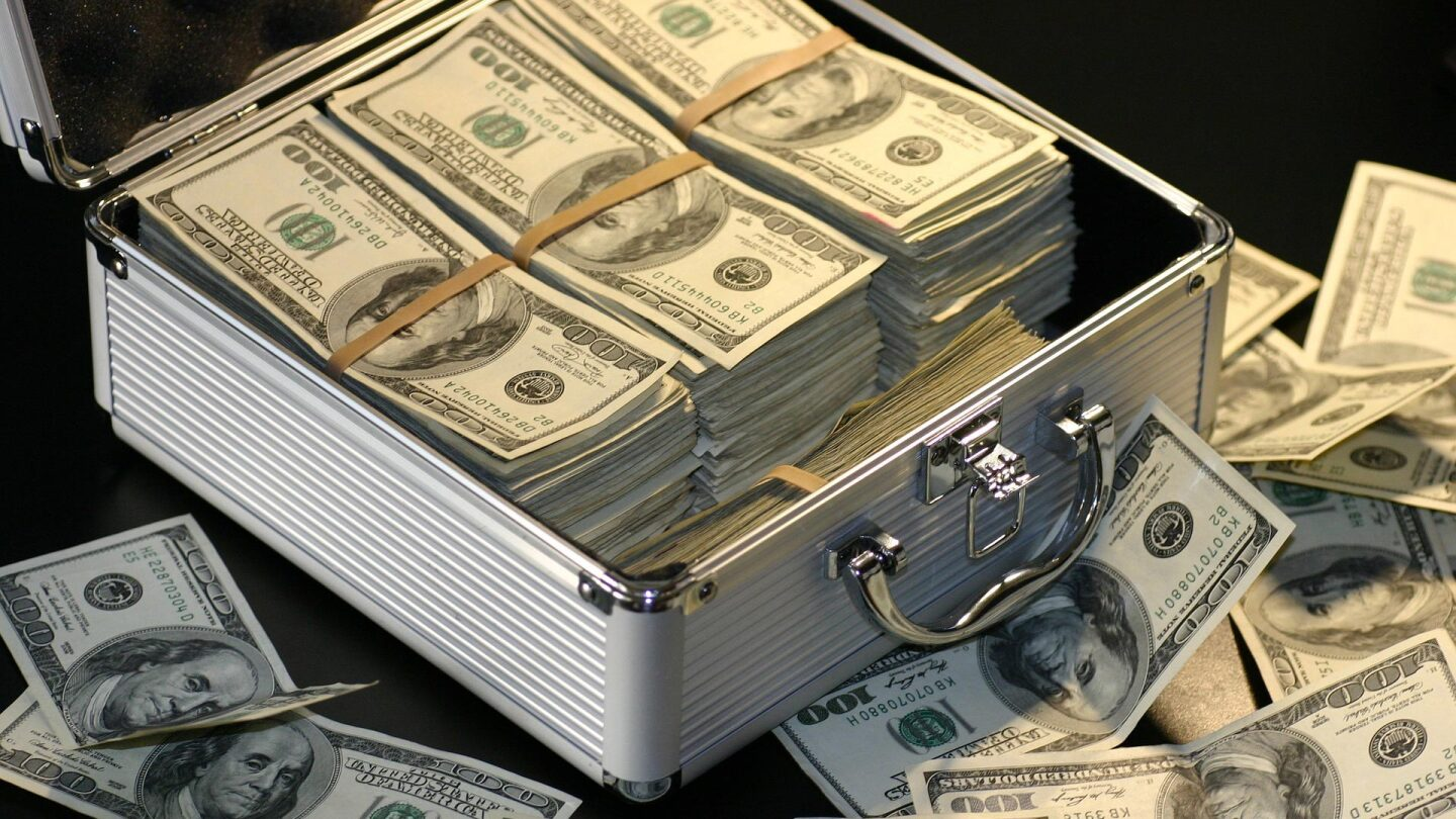 $100 bundles arranged in a silver briefcase.   Flickr/Wall Boat/Creative Commons/Public Domain