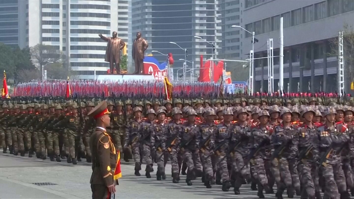 North Korea military marches down a major city street. | Trust Docs