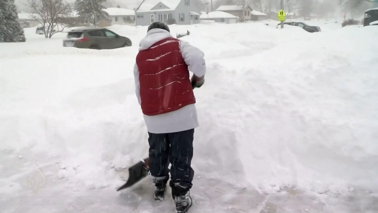 A Texas resident shovels thick layers of snow.