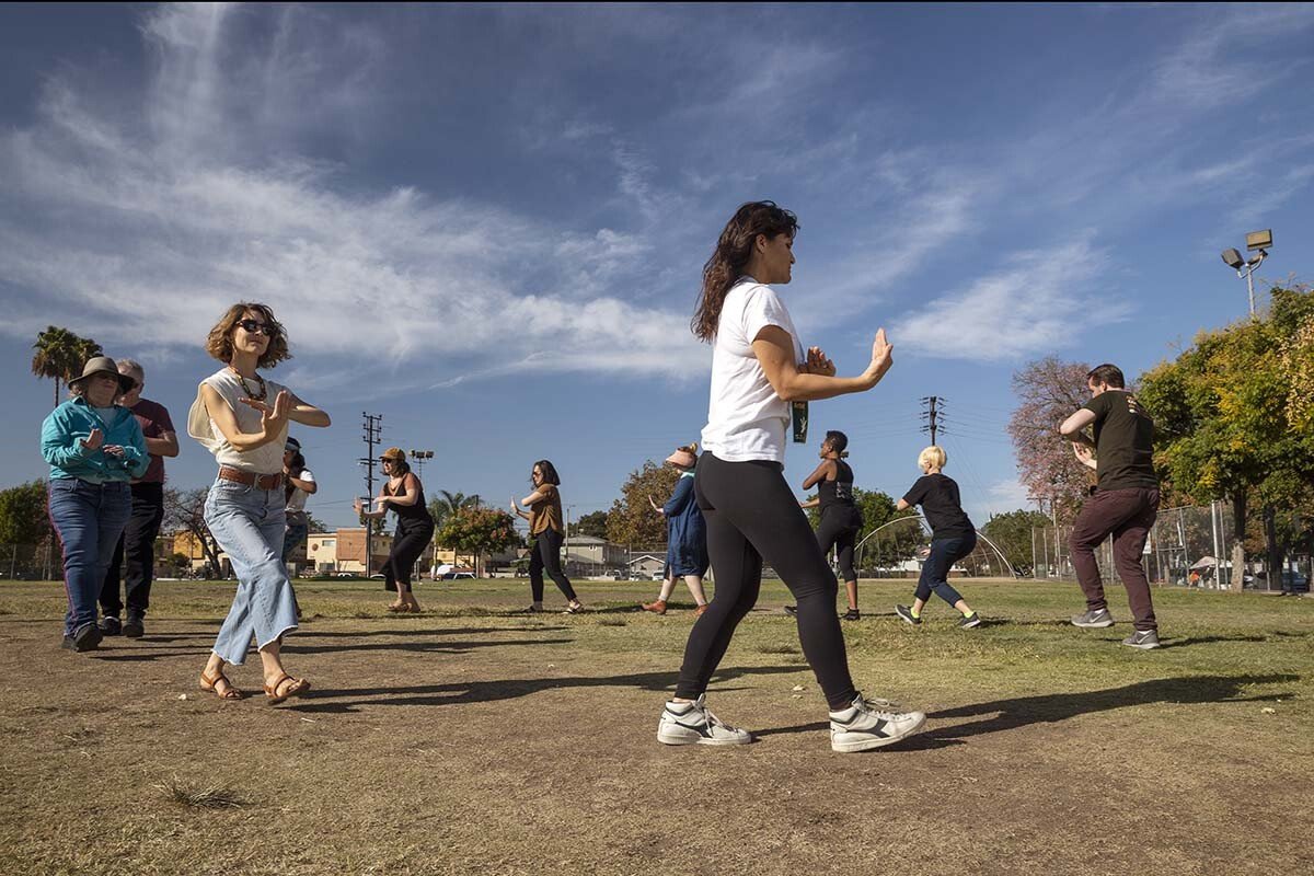 """Rehearsals of """"ALL AGAIN"""" by a community chorus show people executing moves in a circle."""