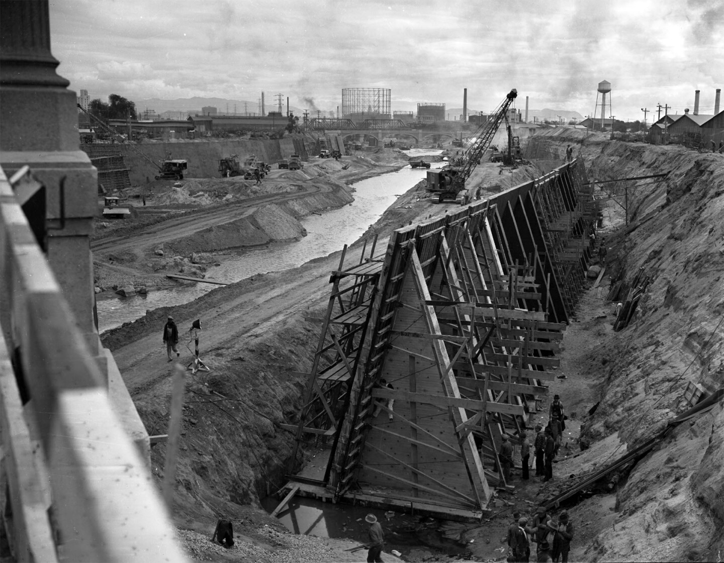 Workers building framing for concrete and digging during reconstruction of Los Angeles River, Calif., 1938