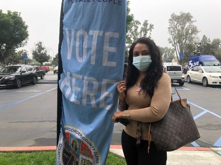 Maryam Danishwar, 39, votes in her first election at the L.A. Registrar in Norwalk. | Carla Javier/LAist