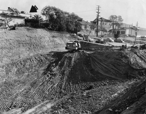 A steam shovel digs a trench for Fourth Street through Bunker Hill, directly beneath Stuart Oliver's house, in 1954. Courtesy of the Herald-Examiner Collection - Los Angeles Public Library.