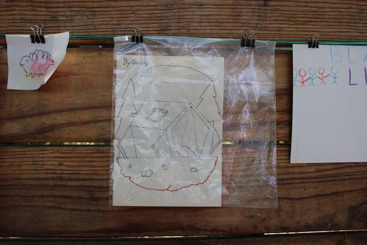 A drawing of a forest hangs on Dan Fields' Los Feliz fence gallery