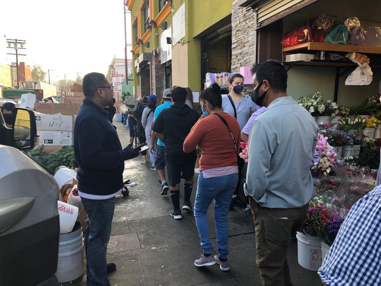 Line outside of Flower Market on May 8, 2020 | Karen Foshay