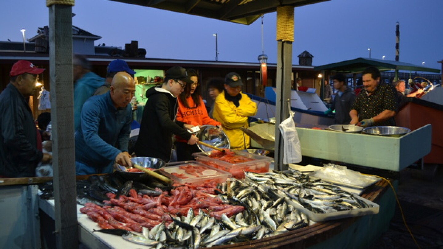 Seafood lovers flock to Newport Beach's Dory Fleet market to find fresh fish. | Photo: Alicia Clark/KCET