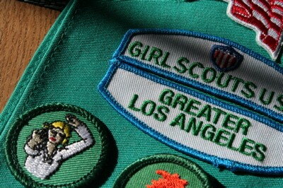 Girl Scout sash with badges