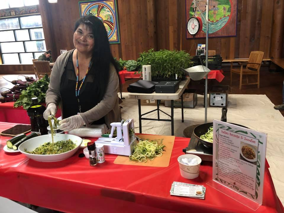 A Potawot staff member preparees a spiralized zucchini recipe for a taste test. | Courtesy of Potawot Community Food Garden's Facebook page