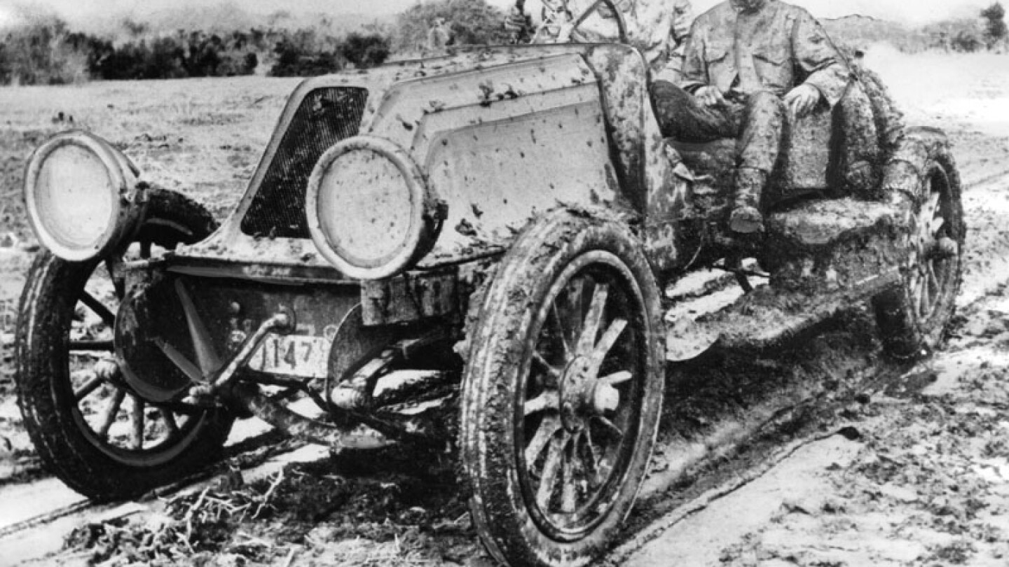 "Mud splatters Ralph Hamlin while competing in the Cactus Derby of 1912. His companion is likely Andrew Smith, the Franklin's ""mechanician."""