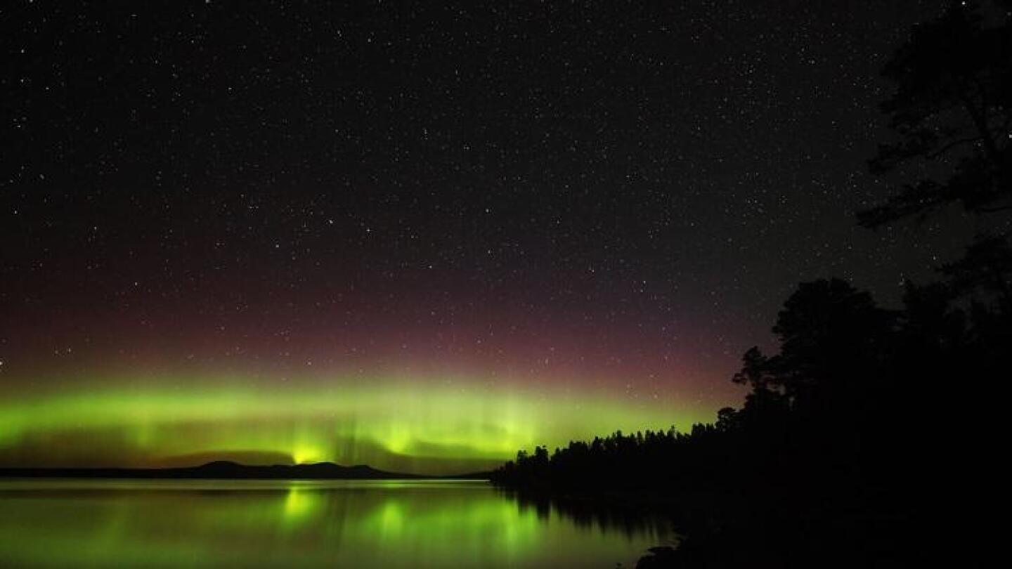 The aurora — a ghostly flicker and colorful glow.