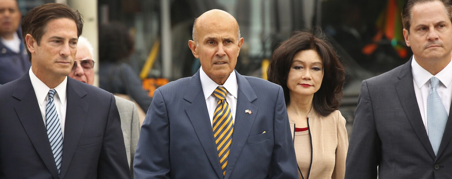 Former Los Angeles County Sheriff Lee Baca, walking with wife and attorneys to a court hearing in 2017 cropped