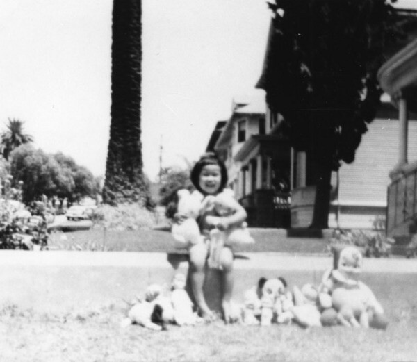 Hawaiian Girl playing with dolls on Bonnie Brae. Courtesy of Los Angeles Public Library