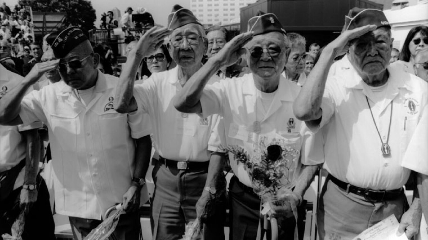 Japanese-American veterans execute salute at WWII memorial in Little Tokyo, Los Angeles