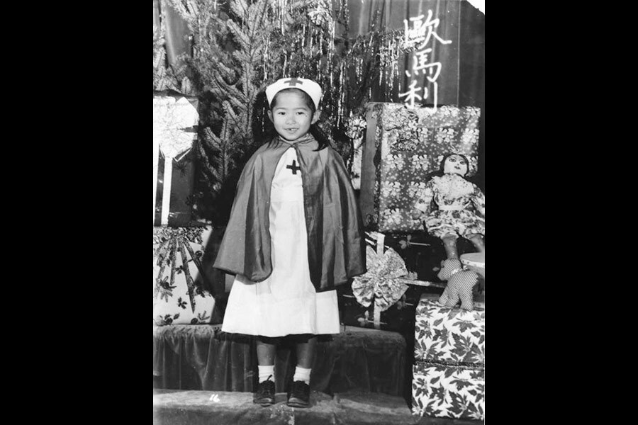 Little Chinese American girl poses in a nurse costume