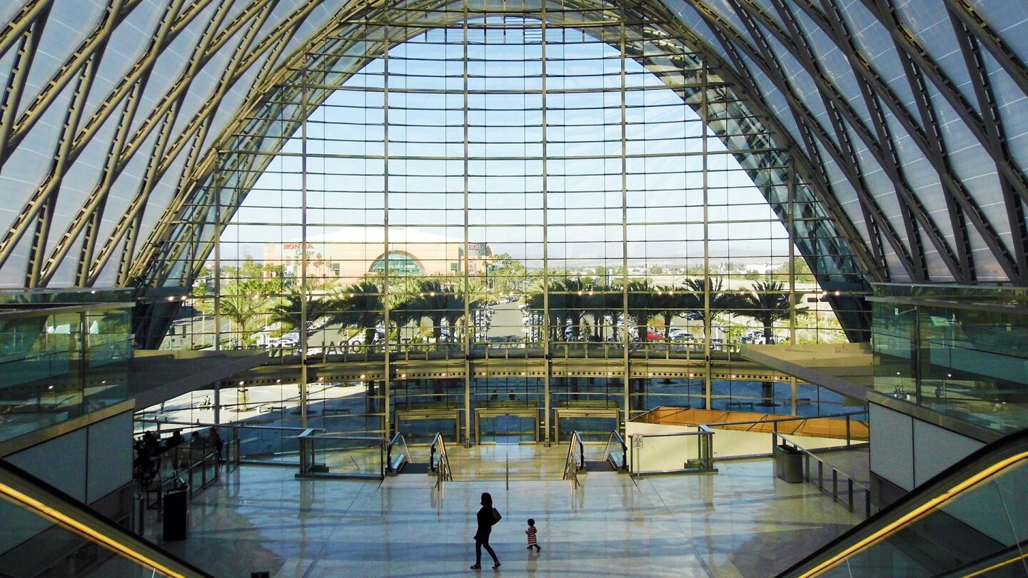 Many wide, curved windows line the walls of the Anaheim Regional Transportation Intermodal Center.