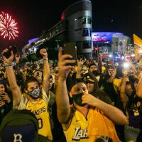Los Angeles Lakers fans gather near the Staples Center to celebrate the Lakers 106 - 93 game 6 over the Miami Heat on Sunday, Oct. 11, 2020 in Los Angeles. | Jason Armond / Los Angeles Times via Getty Images