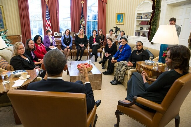 President Barack Obama and First Lady Michelle Obama meet with mothers regarding the Affordable Care Act in the Oval Office, Dec. 18, 2013.