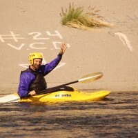George Wolfe waves from his kayak in the Glendale Narrows in 2009 | Photo by KCET Departures