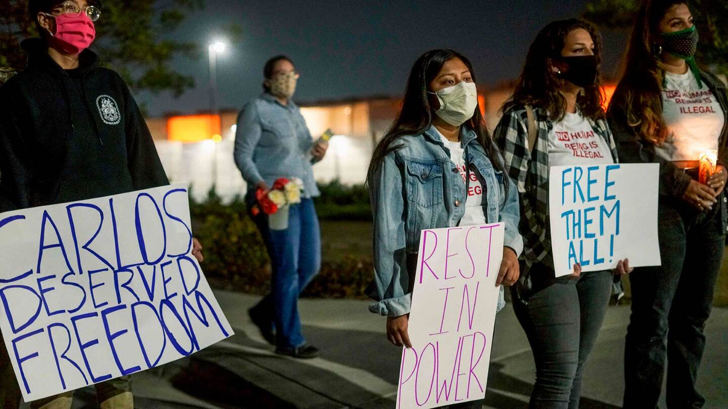 "Protesters stand outside Otay Mesa Detention Center during a ""Vigil for Carlos"" rally on May 9, 2020 in Otay Mesa, California."