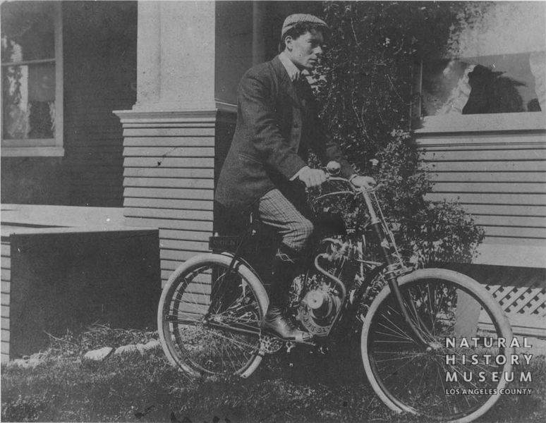 "Hamlin on his ""Orient"" Motorcycle around 1901. The bike was the first motorcycle west of the Rockies. Natural History Museum of Los Angeles County, P-115 Ralph Hamlin Collection"