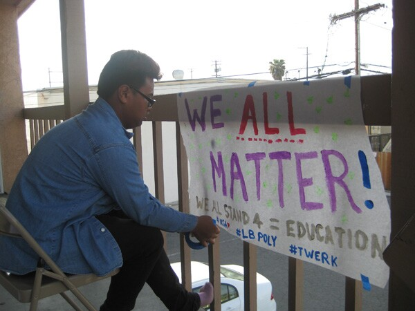 YMEP member Somnon Kann, creating a banner for the Every Student Matters Campaign launch in March 2012