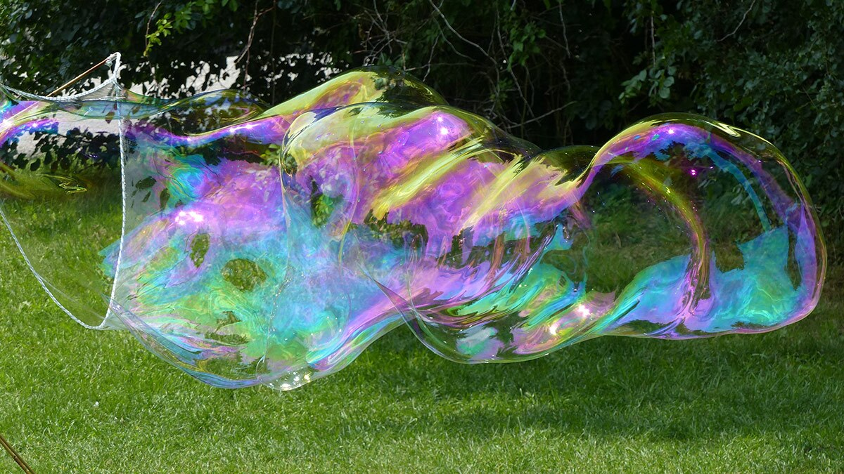 A large bubble being created with a large wand.