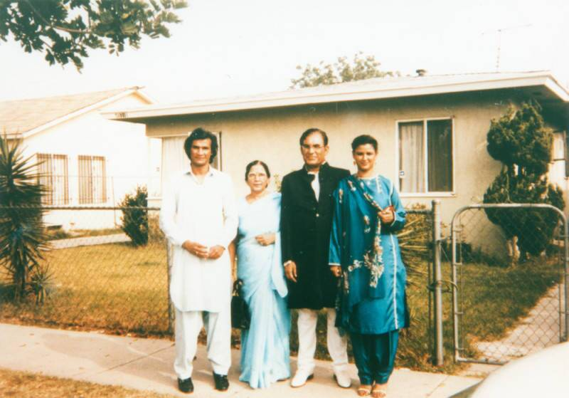 Syed and Qaiser with their children Qamar and Faozia in front of a home in Los Angeles.