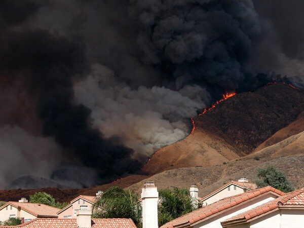 The Old Fire burning above the city of Highland in October 2003.