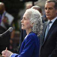 Los Angeles County Public Health director Barbara Ferrer speaks as Los Angeles Mayor Eric Garcetti (R) looks on at an Los Angeles County Health Department press conference on the novel coronavirus, (COVID-19)