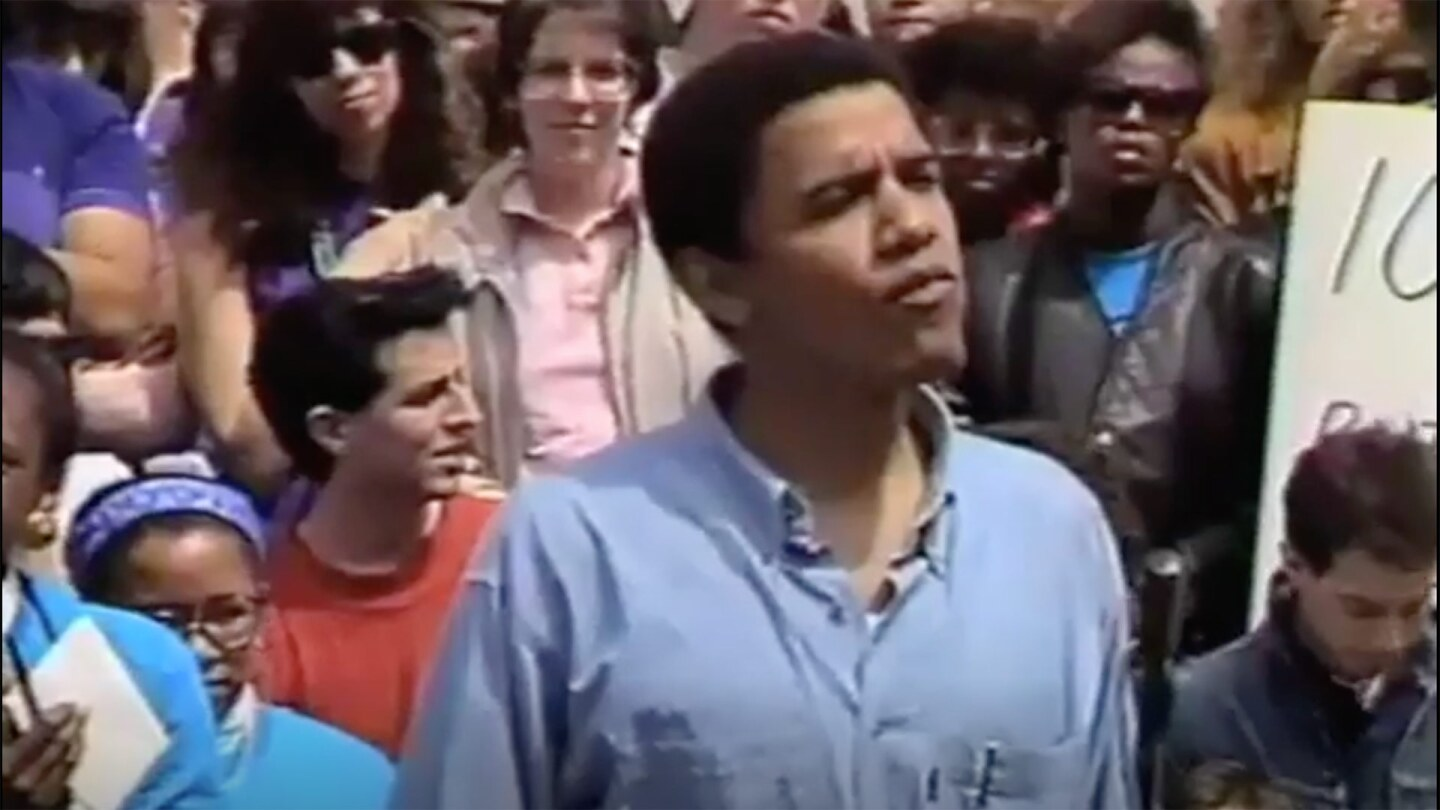 A young Barack Obama introduces Professor Derrick Bell at a 1991 rally advocating for diversity at Harvard Law School