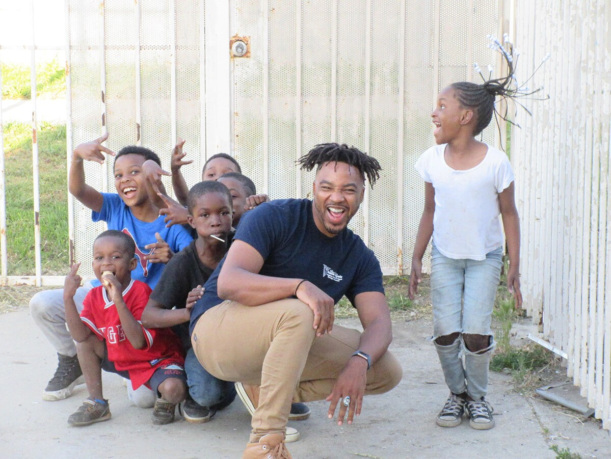 "Bruce Lemon Jr. playing with youth during a rehearsal break of "" A Jordan Downs Illumination.""