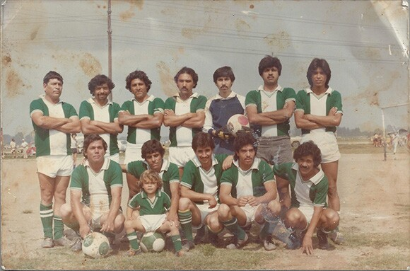 Nicholas Guzmán, shown here in his blue goalie's jersey, with his soccer team.