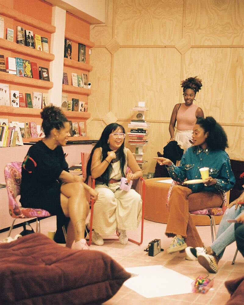 People mingle at the Reparations Club. | Cara Elise Taylor