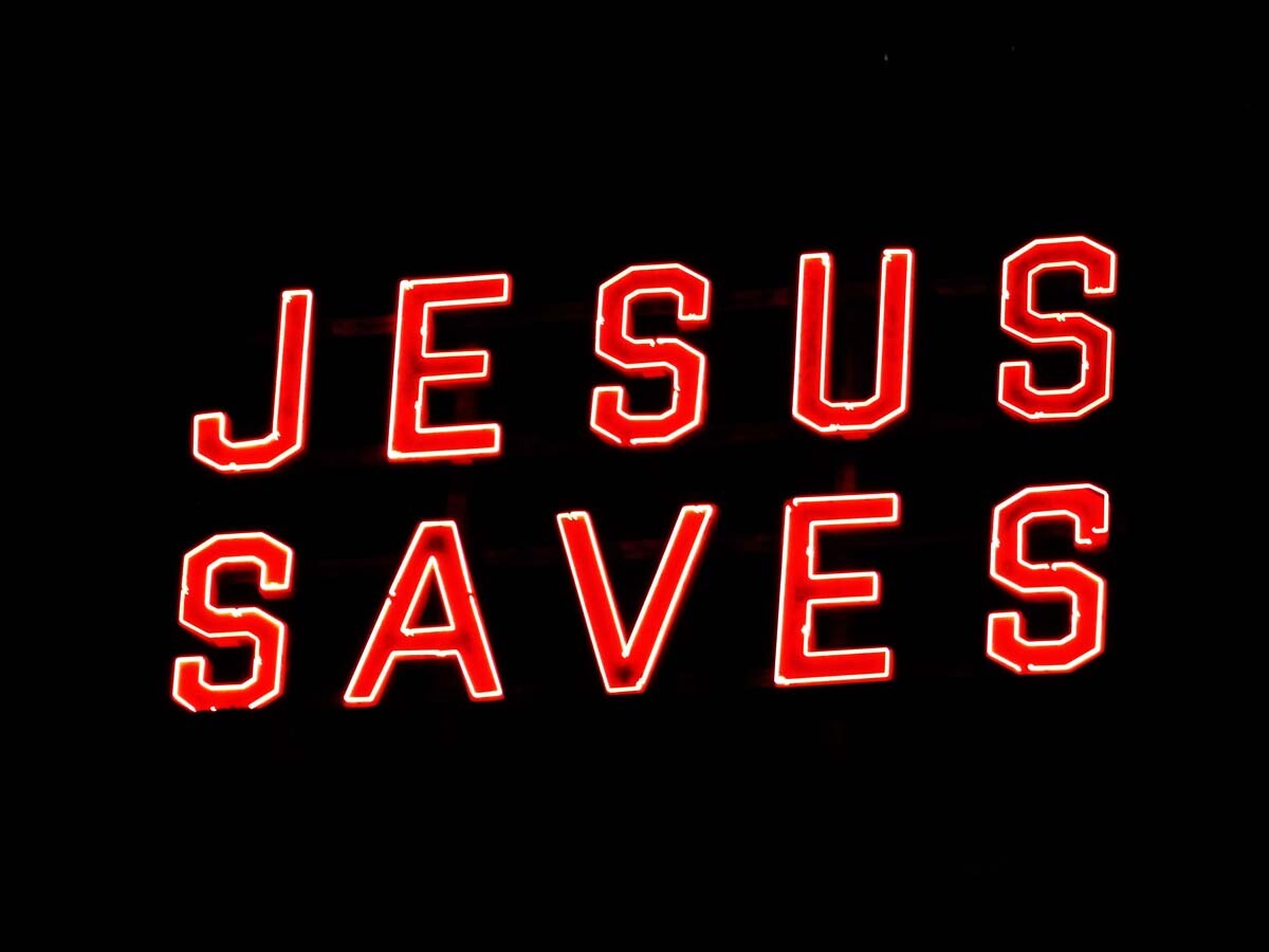 "The Ace Hotel's neon ""JESUS SAVES"" sign. 