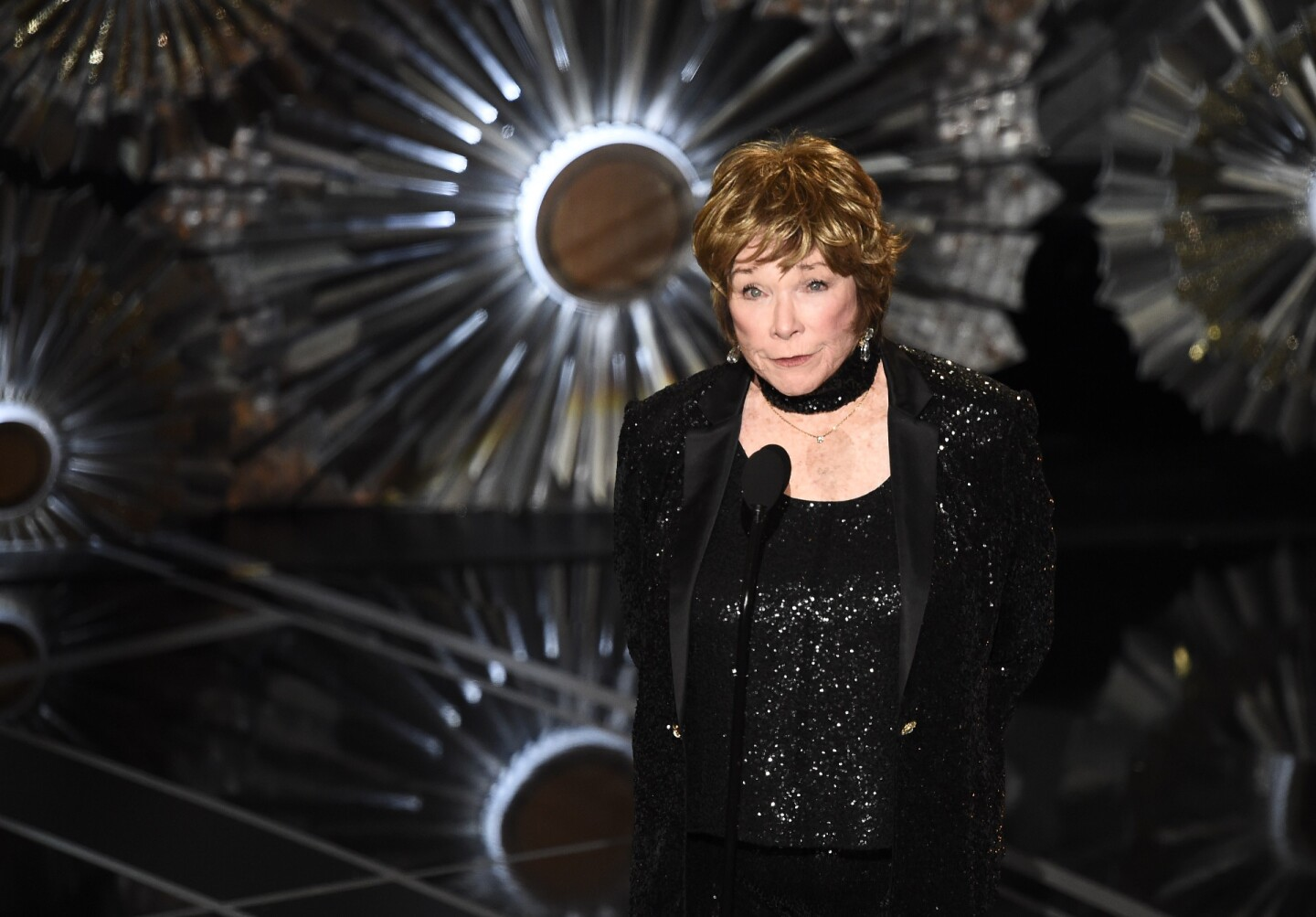 Shirley Maclaine presents an award at the 87th Oscars February 22, 2015