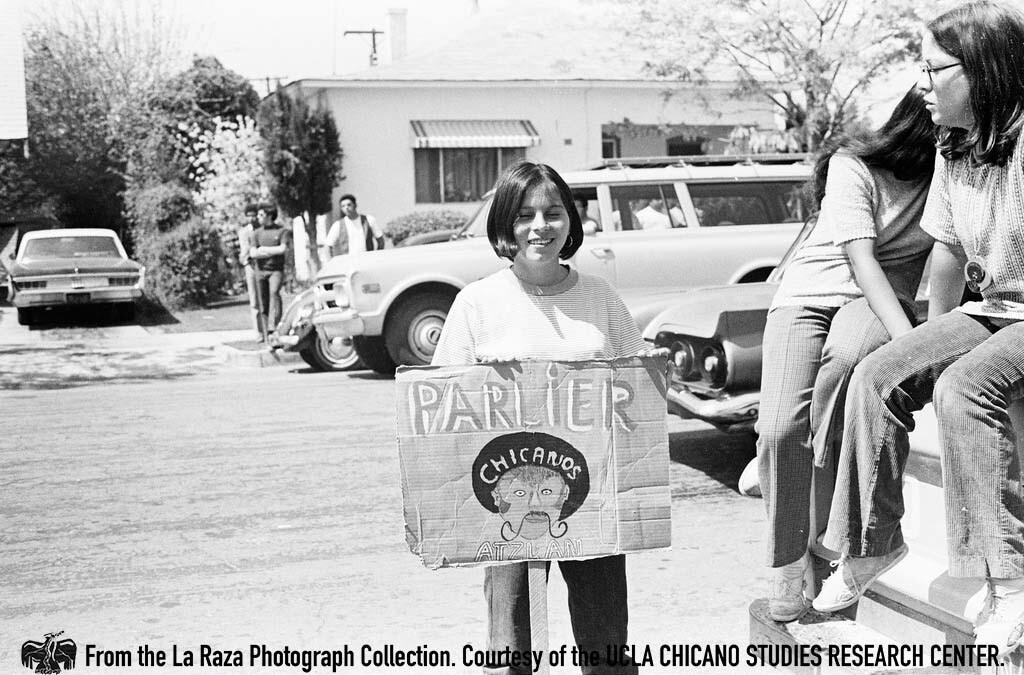 CSRC_LaRaza_B5F3C9_PB_026 Protester at the Fresno Moratorium | Patricia Borjon Lopez, La Raza photograph collection. Courtesy of UCLA Chicano Studies Research Center
