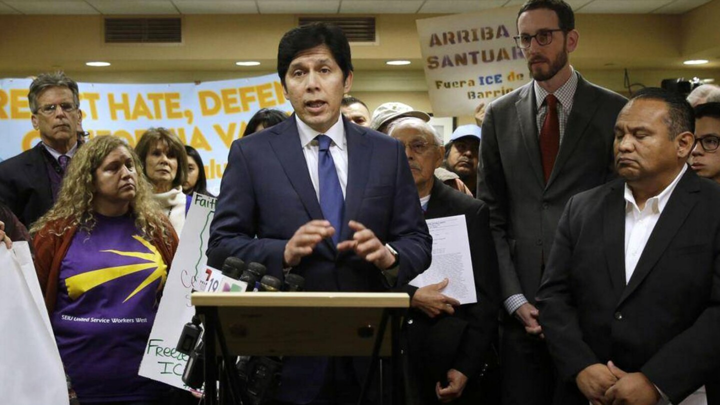 Senate President Pro Tem Kevin de Leon with supporters of his bill to prohibit local law enforcement from cooperating with federal immigration authorities. | photo RICH PEDRONCELLI-AP