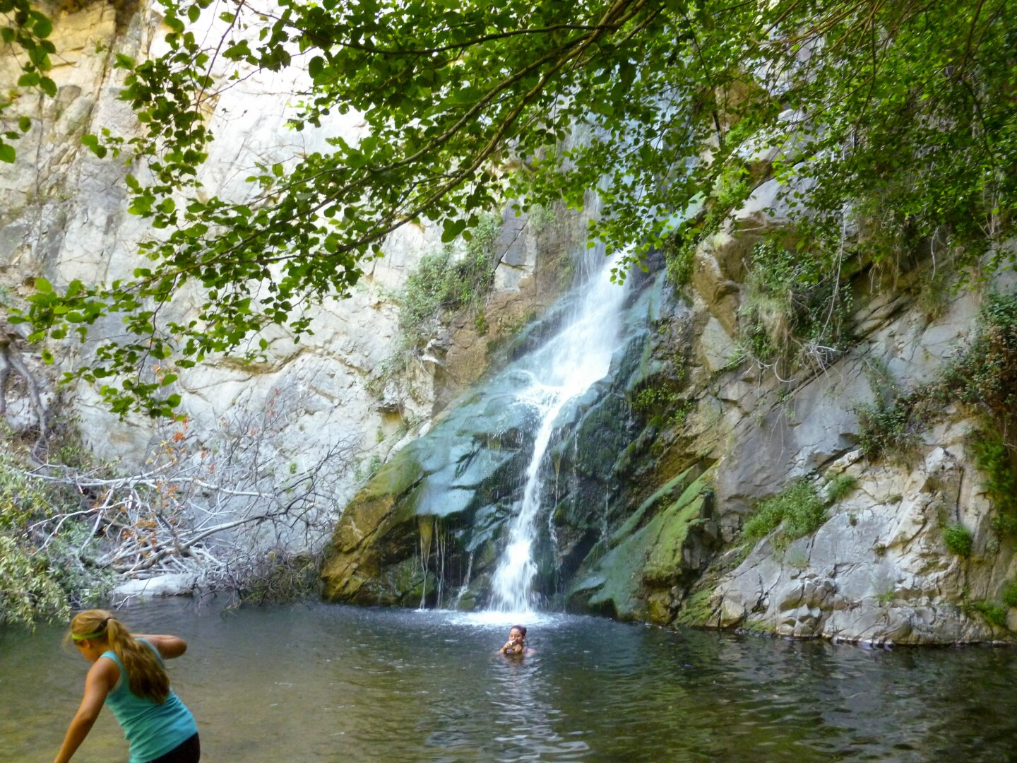 Hikers enjoy a swim in the pool of water from the Sturtevant Falls in Big Santa Anita Canyon.