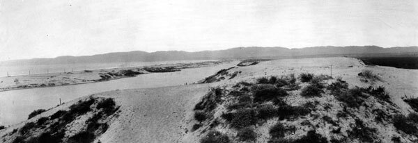 Sand dunes in the Ballona Lagoon wetlands. Left of the dunes is Ballona Lake, which is separated from the Pacific Ocean by a narrow sandbar. Courtesy of the Photo Collection, Los Angeles Public Library.
