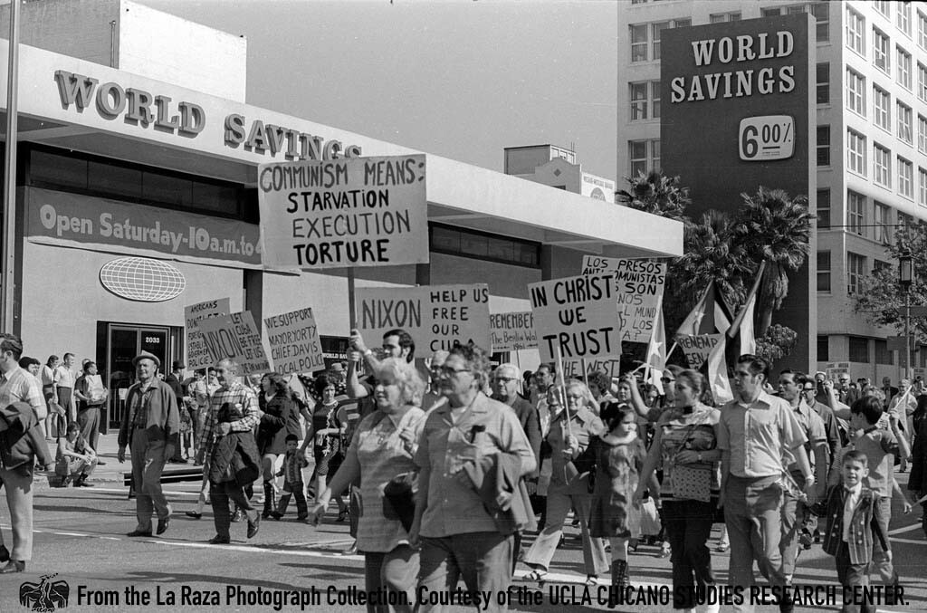 CSRC_LaRaza_B13F11S2_N083 Gusanos anti-communist demonstrators carry banners in Los Angeles | Pedro Arias, La Raza photograph collection. Courtesy of UCLA Chicano Studies Research Center