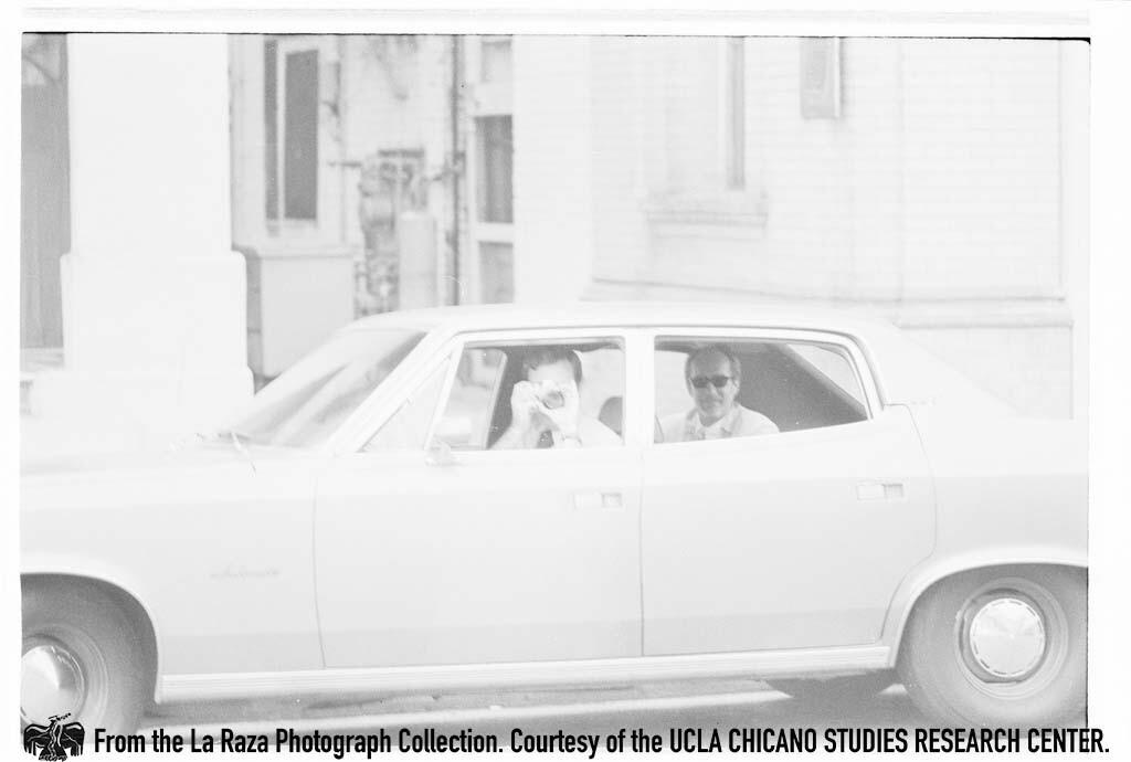 CSRC_LaRaza_B15F4C3_Staff_022 Man photographs at Magnolia Ave Elementary School during the Magnolia Boycott | Sixto Tarango, La Raza photograph collection. Courtesy of UCLA Chicano Studies Research Center