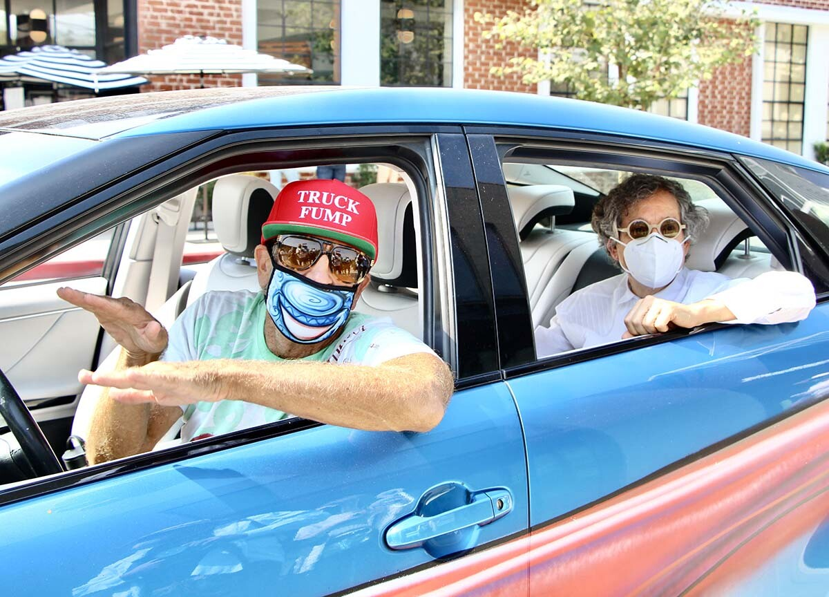"Kenny Scharf and Jeffrey Deitch inside a car during the ""Karbombz!"" car parade 