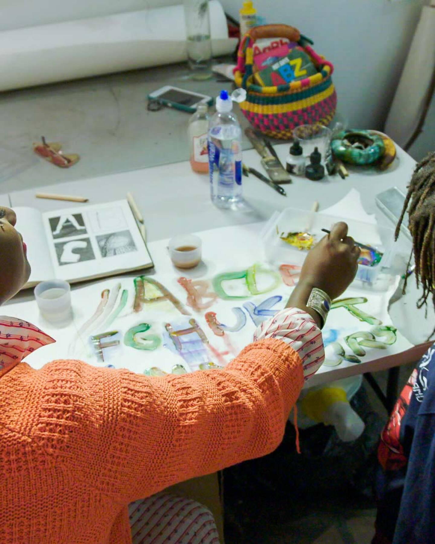 """Artist Kenyatta A.C. Hinkle with her son, Johari   Still from KCET Artbound's """"Artist and Mother"""" Mother AB s9"""