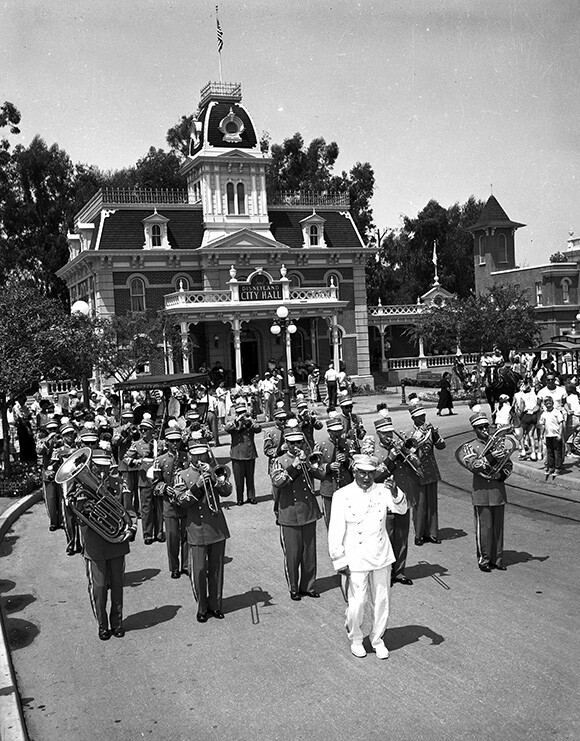 Disneyland Band marching around Town Square on Main Street, U.S.A. in the 1950s. | Photo: Courtesy Disneyland Resort Archives.