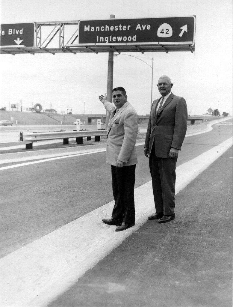 The mayor of Inglewood proudly stands in front of the newly completed San Diego Freeway (I-405) in 1963. Photo courtesy of the Inglewood Public Library.