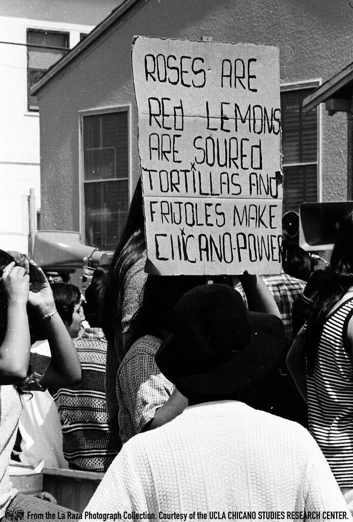 CSRC_LaRaza_B5F3C7_RR_012 People at the Fresno Moratorium | Raul Ruiz, La Raza photograph collection. Courtesy of UCLA Chicano Studies Research Center