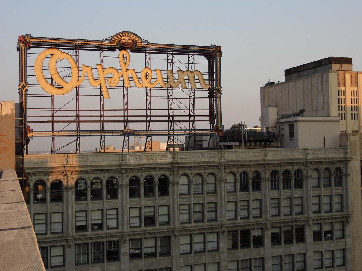 The Orpheum Theatre's original rooftop sign at sunset. | Sandi Hemmerlein